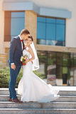 Young wedding couple kissing outdoors Royalty Free Stock Image