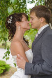 Young wedding couple kissing. Romantic portrait. Young wedding couple kissing outdoors. Romantic portrait Royalty Free Stock Image