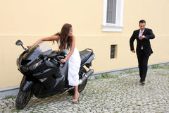 Young wedding couple with motorbike Royalty Free Stock Images