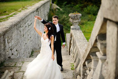 Young wedding couple next to castle. Outside portrait Royalty Free Stock Photo