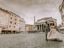Young wedding couple by the Pantheon in Rome, Italy royalty free stock photos