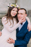 Young wedding couple posing outside on the stairs of atique building with columns.  Stock Photography