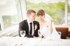 Young wedding couple in restaurant. Groom and bride together. Stock Photography