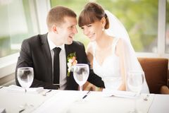 Young wedding couple in restaurant. Groom and bride together. Royalty Free Stock Photos