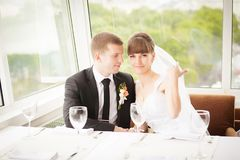 Young wedding couple in restaurant. Groom and bride together. Royalty Free Stock Images