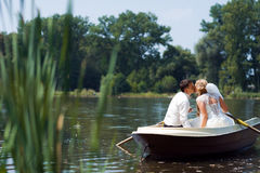 Young wedding couple sailing on the boat Stock Images