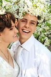 Young wedding couple in spring blossom Royalty Free Stock Photo