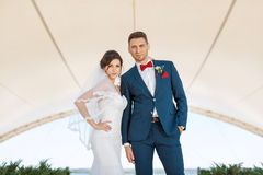 Young wedding couple standing outdoors Royalty Free Stock Photography