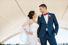 Young wedding couple standing outdoors Royalty Free Stock Image