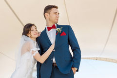 Young wedding couple standing outdoors Royalty Free Stock Photos