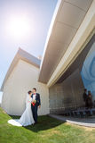 Young wedding couple standing outdoors Stock Photography