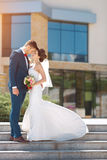 Young wedding couple standing outdoors Royalty Free Stock Images