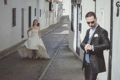 Young wedding couple in the street stock image