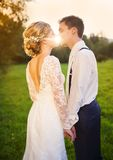 Young wedding couple on summer meadow Royalty Free Stock Photos