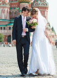 Young wedding couple walking. On Red Square Royalty Free Stock Images