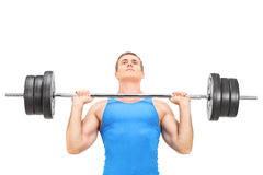 Young weightlifter training with a heavy barbell Stock Image