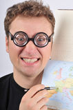 Young weird man holding map. Caucasian young man dressed like nerd holding map Stock Image