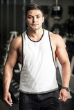 Young well built man training in a gym Royalty Free Stock Photography