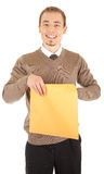 Young well-dressed man with an envelope. Young well-dressed man in formal wear is holding a open yellow envelope. Isolated on white background Stock Photography