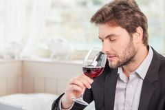 Young well-dressed man is relaxing in restaurant Royalty Free Stock Photo