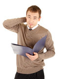 Young well-dressed thinking man with documents Royalty Free Stock Photos