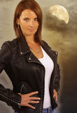 Young werewolf - beautiful woman wearing a leather jacket Royalty Free Stock Image