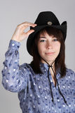 Young western cowgirl in black hat and blue shirt Royalty Free Stock Images