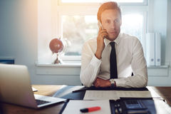 Young white business man talking on the phone Royalty Free Stock Images
