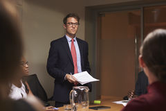 Young white businessman addresses team at meeting, low angle royalty free stock photos