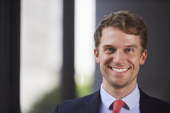 Young white businessman smiling, close up Stock Image