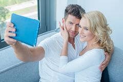 Young White Couple Taking Self Photos Royalty Free Stock Image