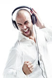 Young white dressed dj listening to music Royalty Free Stock Photography