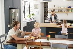 Free Young White Family Busy In Their Kitchen, Elevated View Royalty Free Stock Photo - 119403905