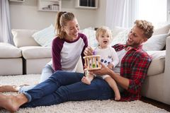 Young white family playing together in sitting room royalty free stock image