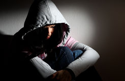 Upset girl in hood Royalty Free Stock Photo