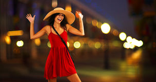 Young white girl standing on the pier in a red sun dress and floppy hat.  Royalty Free Stock Images