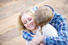 Young white male kissing his fiance Royalty Free Stock Images