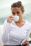 Young white woman. Drinking coffee Stock Photo