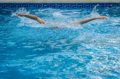 Young woman swimming to breaststroke in the pool stock photo