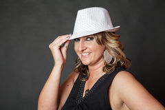 Young white woman wearing white pinstripe hat Royalty Free Stock Photography