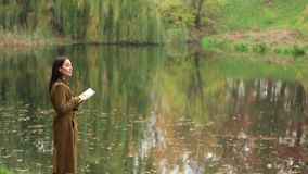 Girl Writes At Autumn Landscape stock video