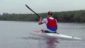 Young Whitewater Kayaker. Zabalj;Serbia; 08.03.2016.National team rowers in a kayak on the preparations for the Summer Olympic Games 2016. Video clip stock video footage