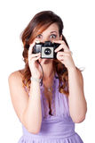 Surprised woman taking picture with old camera Royalty Free Stock Image