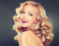Young wide smiling blonde model. Stock Images