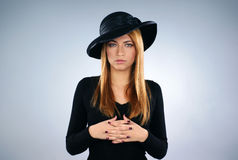 A young widow in black dress with a hat Stock Photo