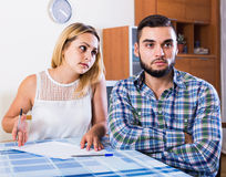 Young wife complaining of banking debts Royalty Free Stock Photos