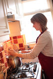 Young Wife Cooking at Home Royalty Free Stock Photos