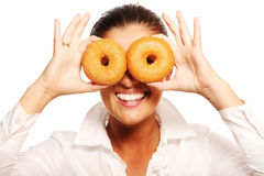 Young wife playing with donuts Stock Images