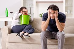 Young wife suffering from sick stomach and vomiting. The young wife suffering from sick stomach and vomiting stock photo