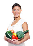 Young wife and vegetables Royalty Free Stock Photos